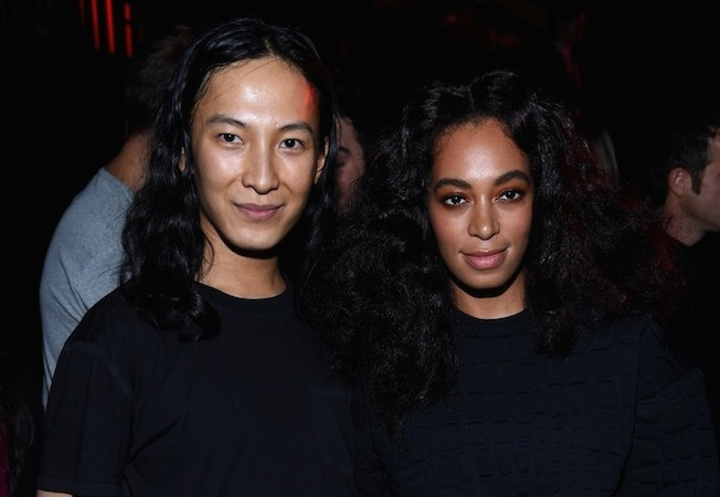 NEW YORK, NY - OCTOBER 16:  Designer Alexander Wang (L) and artist Solange Knowles pose backstage at the Alexander Wang X H&M Launch on October 16, 2014 in New York City.  (Photo by Dimitrios Kambouris/Getty Images for H&M)