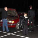 Dad, Ben, Caleb and friend Steve Oswell examining the red car.