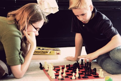 Leesha and Caleb engrossed in chess.
