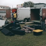Moving all of our equipment from the old trailer to the new—in between rain showers! (February, 2016)