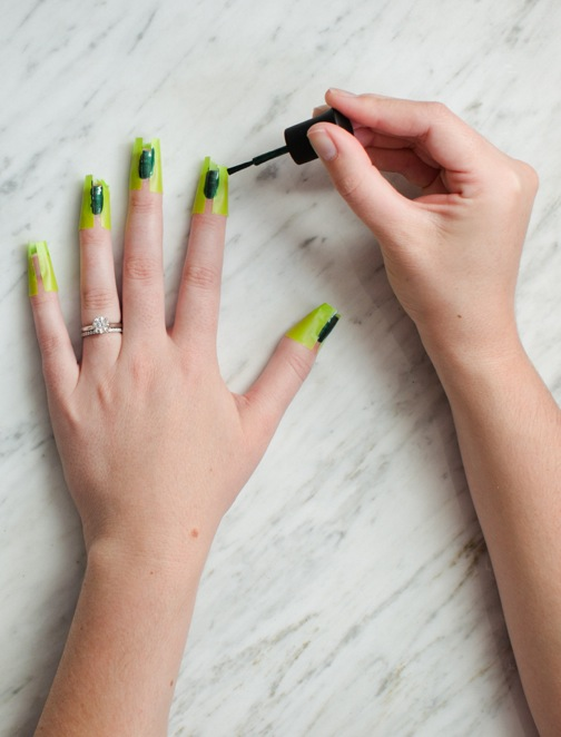nail art with tape and hunter green polish