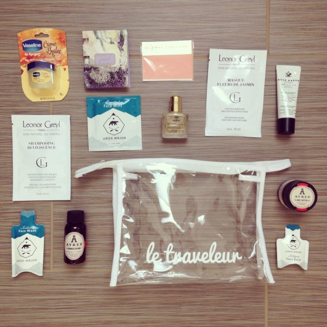 clear plastic bag with sample-sized beauty products
