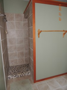 Entrance to walk in shower. Notice hand made fir trim and towel rack
