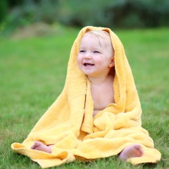 cute baby in yellow towel