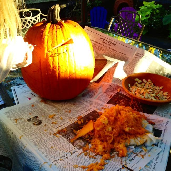 green diva jessie carving a pumpkin
