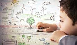 boy playing with renewable energy drawing on the green divas