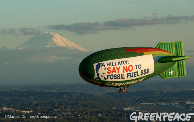 Greenpeace image of Hillary Clinton balloon on the green divas