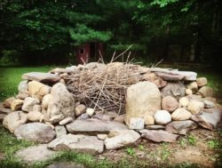 A re-built stone firepit.