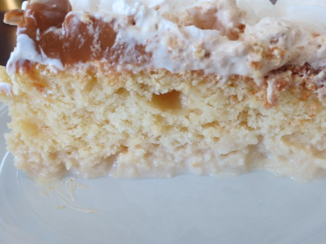 A closeup of the beautiful layers of the tres leches cake