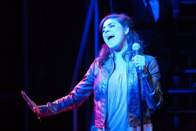 """Television show contestant Brianna (Maria Rizzo) croons a lovesick tune in """"Spin."""" The show plays at Virginia's Signature Theatre through July 27, 2013. Photo: Teresa Wood."""