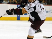 Karl Alzner takes a shot while playing with the Hershey Bears