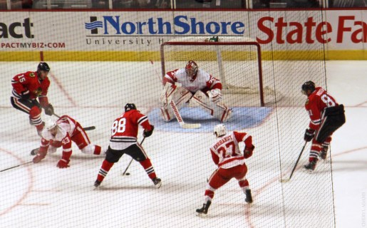 Patrick Kane and Marian Hossa rush the net
