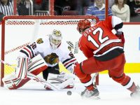 Chicago Blackhawk Corey Crawford, Carolina Hurricane Eric Staal - Photo by Andy Martin Jr
