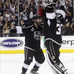 Drew Doughty celebrates with goaltender Jonathan Quick after winning the Stanley Cup. (Jerry Lai-US PRESSWIRE)