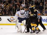 Lucic: Goalie terrorist - Moments after the Milan Lucic hit on Ryan Miller (Greg M. Cooper-US PRESSWIRE)