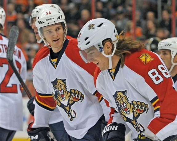 Peter Mueller (88) celebrates his goal with teammate center Jonathan Huberdeau