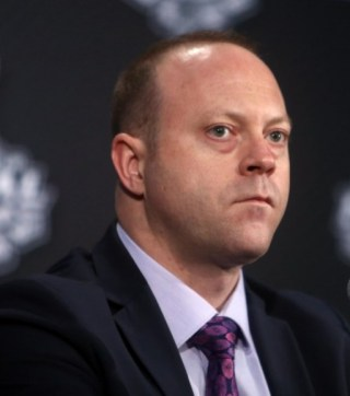 Stan Bowman has work to do to bring the Blackhawks under the Salary Cap