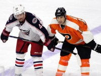 Scott Hartnell (#43) and RJ Umberger (#18) faceoff against each other. [photo: Amy Irvin]