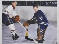 Jean Beliveau tries on Johnny Bower.
