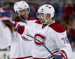 Montreal Canadiens defensemen Tom Gilbert and Andrei Markov