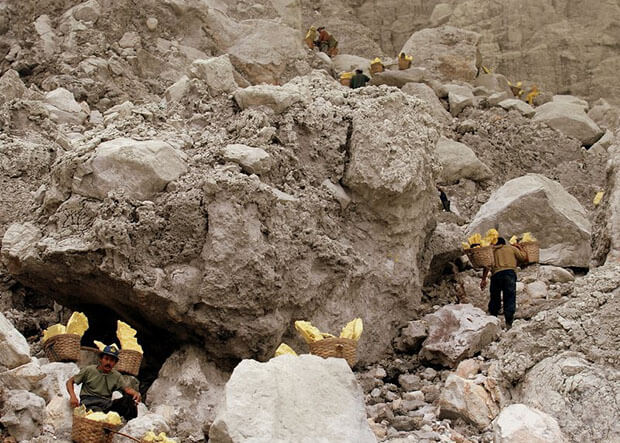 Sulphur miners at Mount Ijen in Indonesia