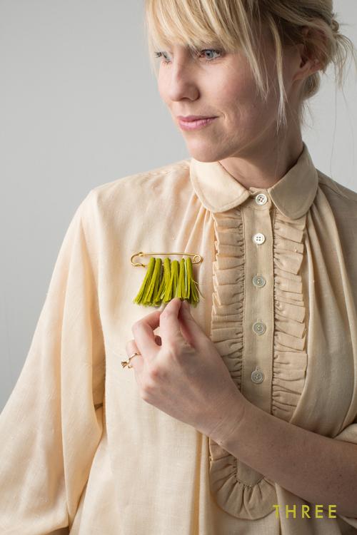 green tassle pin