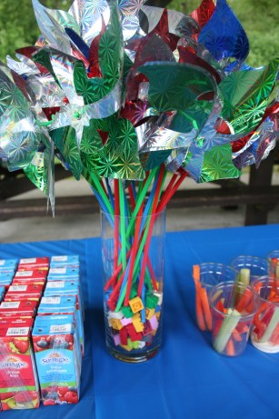 """Pinwheels for a """"bouquet"""" at a birthday party.  Give them away as party favours after."""
