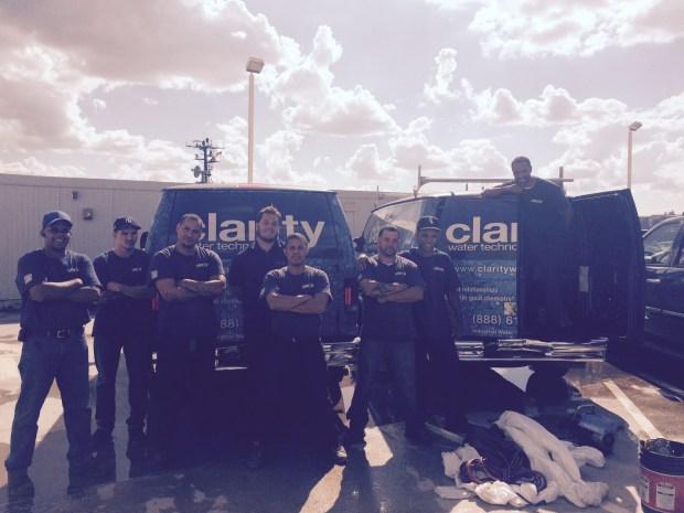 Reynaldo Noyola (far right) and his team at Clarity Water Technologies continue to stay busy after a new law mandates cooling towers be tested and checked on a quarterly basis. (Photo credit: Clarity Water Technologies)