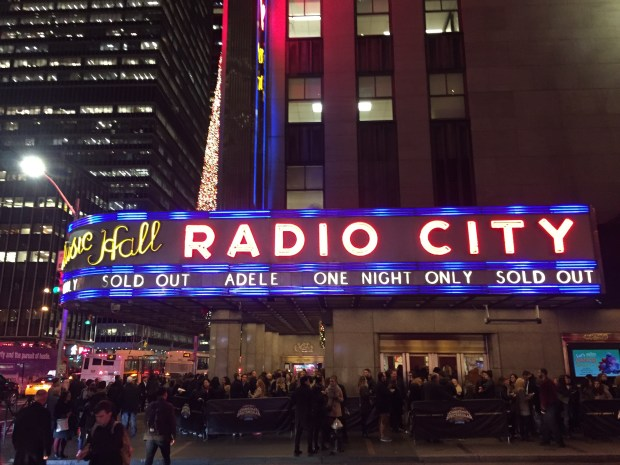 The line of people waiting to see Adele's first concert in the US since 2011 stretched around the block at the Radio City Music Hall, but many local salesmen were left shorthanded. (Photo: David Roza)
