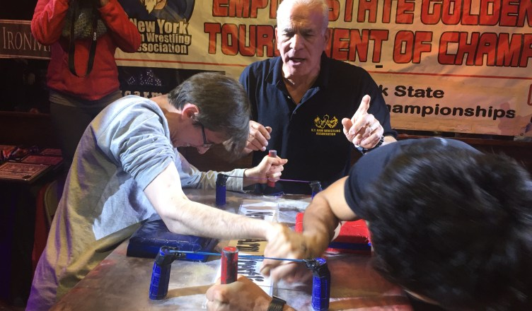 Two men face off in the 39th Annual Empire State Golden Arm Tournament of Champions in Queens. (The Ink / Amy Lu)