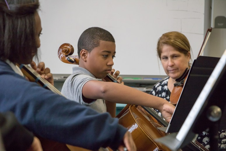 Gian Mercado (middle) comes to the orchestra room to practice during lunch break. (Timmy H.M. Shen / The Ink)