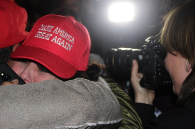 Trump supporters embrace after official announcement that Trump has won. (The Ink/Nadeem Shad)