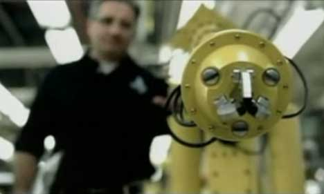 Yellow robot faces quality failure in GM TV ad