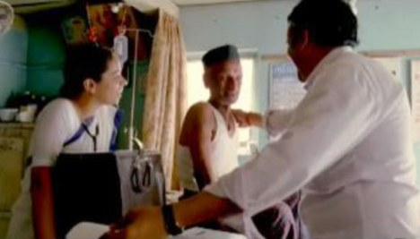Doctor uses small electrocardiograph in an Indian clinic
