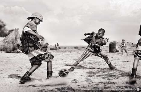 Child soldiers playing soccer with a human skull in Amnesty International print campaign