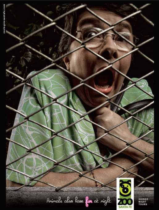 Frightened woman in Santa Fe Zoo print advertisement