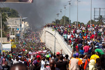 Thousands of demonstrators march in the street as they chant anti-government slogans during a protest to demand the resignation of President Jovenel Moise and demanding to know how Petro Caribe funds have been used by the current and past administrations, in Port-au-Prince, Haiti, Thursday, Feb. 7, 2019. Much of the financial support to help Haiti rebuild after the 2010 earthquake comes from Venezuela's Petro Caribe fund, a 2005 pact that gives suppliers below-market financing for oil and is under the control of the central government. (AP Photo/Dieu Nalio Chery)