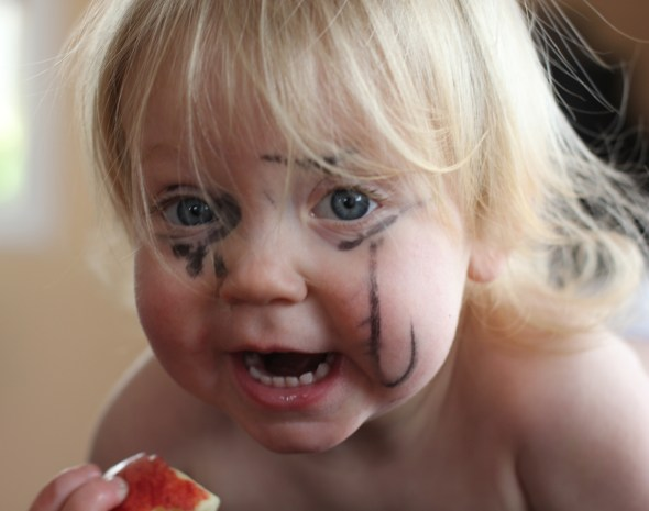 baby with marker all over her face