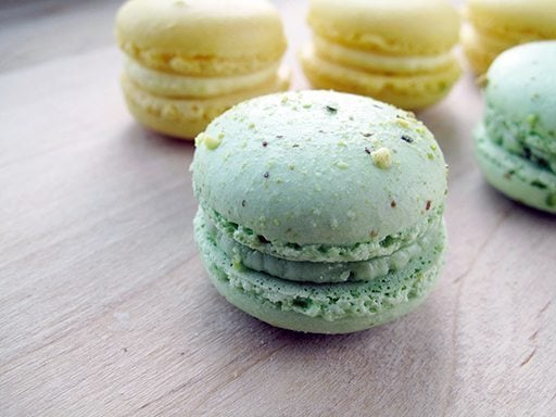 amour, a large macaron lined with rose-cream filled raspberries ...