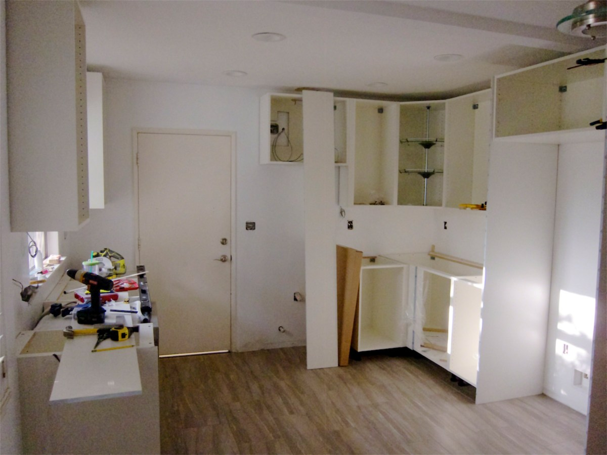 Kitchen renovation diy installation ikea adel cabinets - Ikea corner cabinet door installation ...