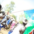 One year ago…South Sudanese men celebrate their independence on July 9, 2011. Photo by Arsenie Coseac, Flickr