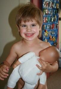Boy pretending to BF doll
