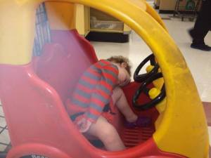 sleeping at the grocery store car cart