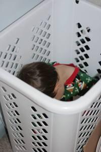 sleeping in a laundry hamper