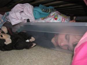 sleeping in under bed storage bin