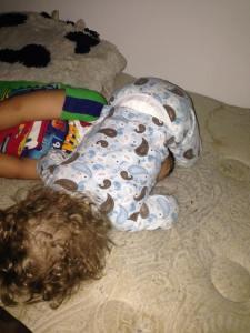 sleeping on brother's head