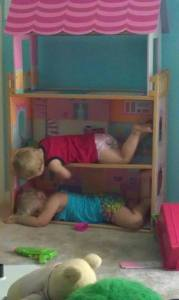 sleeping twins in doll house