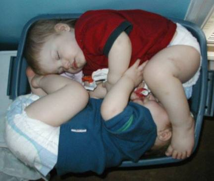 sleeping twins in tub