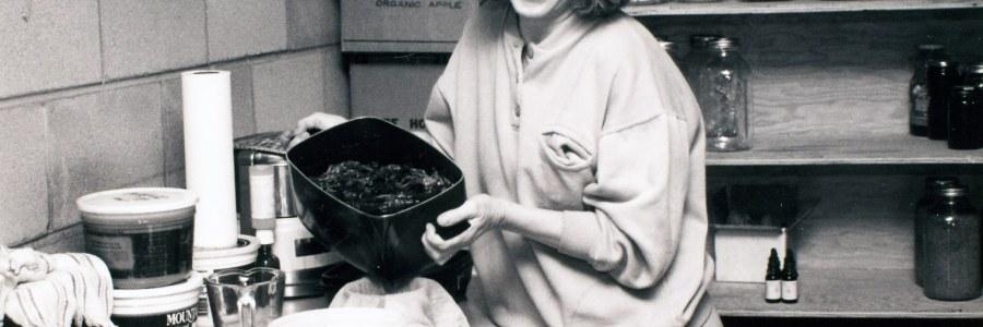 Kathryn, creator of Motherlove, making Green Salve in her kitchen.