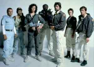 Main cast of Alien in costume in front of a white background